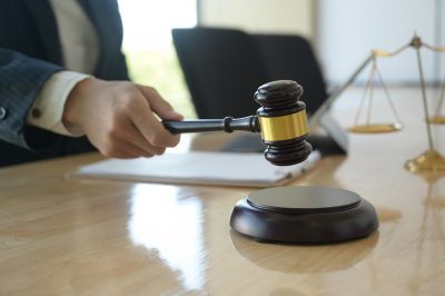 Concept of justice, Lawyer holding a hammer pretending to hit on