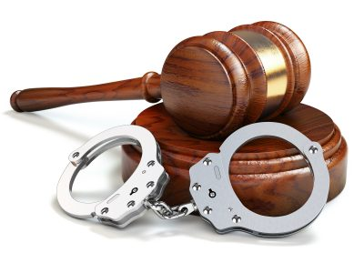 Gavel and handcuffs isolated oin white background. Law and justi