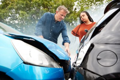 Two Angry Motorists Arguing Over Responsibility For Car Accident