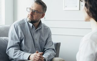 Psychotherapist working with man in office